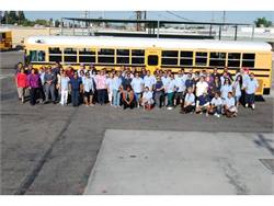 """Orange USD Transportation Supervisor Ellen Johnson (front row, far left) and Director of Transportation Pam McDonald (to Johnson's left) say they take a """"family photo"""" with the bus drivers every school year.Photo by Suzan Grab"""