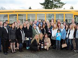 Family members and friends of school bus driver Jennifer Foughty are pictured here in front of her bus. Foughty died unexpectedly in 2013 at age 39.