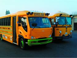 Kings Canyon USD was the first district in the nation to receive an eTrans all-electric school bus (at left) from Trans Tech Bus. The district hopes to acquire five more within the next year.