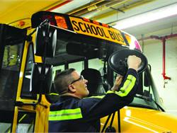 Dan Maybury, a First Student service manager, works on buses running in Hempfield Area School District.