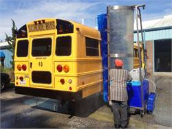 Bitimec's 626-EZ saves more water by applying soap through misting circuits, which also use less soap. The system is shown here washing a school bus at Brunswick County Schools in Bolivia, North Carolina.