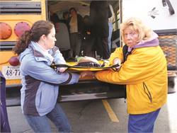 Author Jean Zimmerman (right) says physical therapists will teach transportation personnel how to protect their back and lift students safely when evacuating them from the bus.