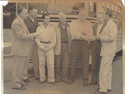 The Santa Monica Unified School District transportation staff receives a driver safety award circa 1951.