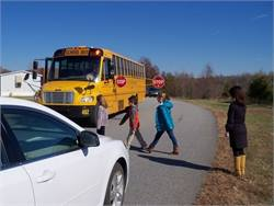 Guilford County (N.C.) Schools is testing the Bus Crossing Guard, a mechanical arm with an extra stop sign that extends 6 feet from the side of the bus.