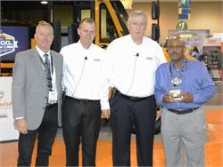 Dwight Bishop Sr. (right) of Bishop Bus Service bought the 75,000th Saf-T-Liner C2 school bus. With him are (from left) Steve Leonard of American Bus Sales and Service and Caley Edgerly and Ken Hedgecock of Thomas Built Buses.