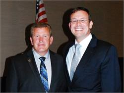 Todd Monteferrario (right) of First Student, begins a two-year term as president of the National School Transportation Association. At left is outgoing President Tim Flood.Photo courtesy NSTA