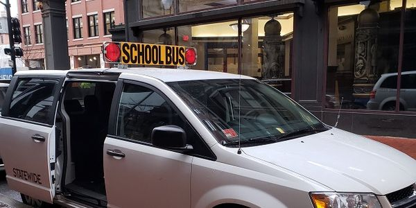 The Rhode Island Department of Education uses eight-passenger minivans to transport its...