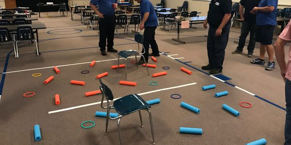 """Management class attendees took part in a leadership game called """"catching a snake"""" with the..."""