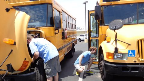 Here, Mesa (Ariz.) Public Schools substitute drivers pre-trip buses in preparation for a run....