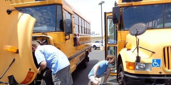 Here, Mesa (Ariz.) Public Schools substitute drivers pre-trip buses in preparation for a run....