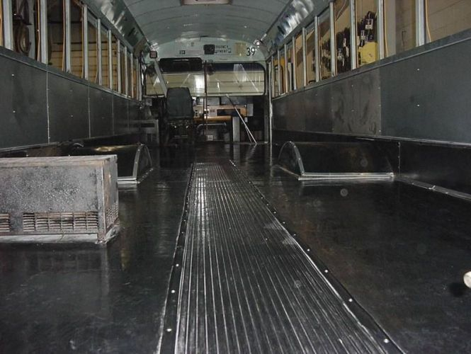 After Laying Down New Wood For The Floor, The Mechanics Replaced The Busu0027  Interior Side Panels, Kick Panels And Wheel Wells.