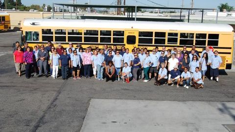 Orange USD Transportation Supervisor Ellen Johnson (front row, far left) and Director of...
