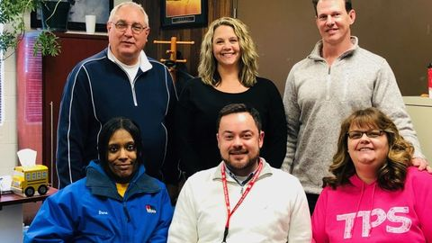 Toledo Public Schools transportation team members, shown here, worked together to identify and...