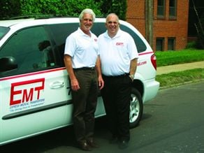 EMT Founder and President Bernie Squitieri (right) and Vice President Chris Kemph pose with one of the company's 200 vehicles in St. Louis.