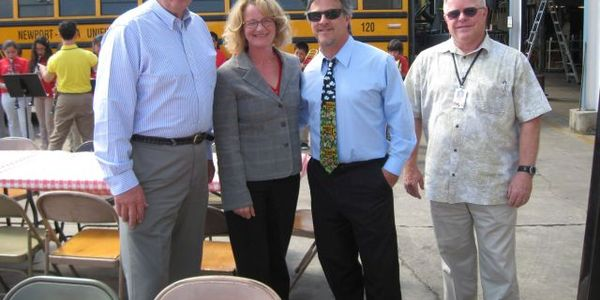 Pete Meslin (in the blue shirt and wearing a tie), director of transportation at California's...