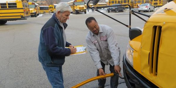 Parkway School District bus driver Chuck Deem (left) and technician Ben Thompson inspect a...