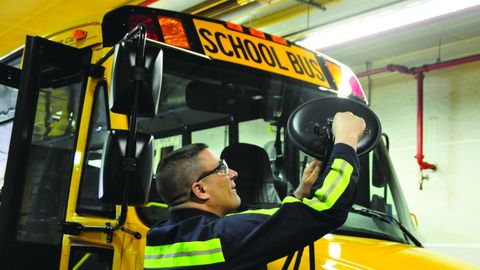 Dan Maybury, a First Student service manager, works on buses running in Hempfield Area School...