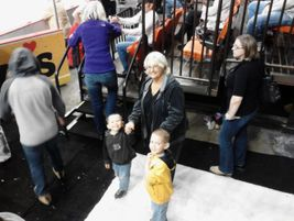 Norman (Okla.) Public Schools bus driver Theresa Callahan, pictured with her two grandsons, was...