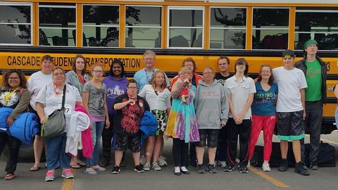 Employees at Cascade Student Transportation volunteered to transport Special Olympics athletes...