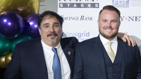 Logan Bus Co.'s Michael Tornabe (left), SBF's Contractor of the Year, is seen here with...