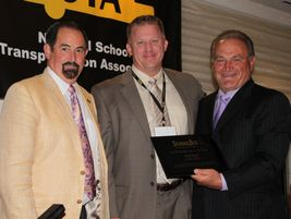 2010: Blake Krapf (center) was named SBF's 43rd Contractor of the Year. He is pictured with...