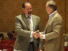 During the membership meeting, NSTA's immediate past president Barry Stock (right) passed the...