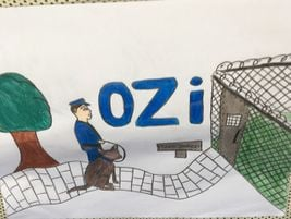 Another poster inside the busshowed Chief Woods walking Ozi into the McSherrystown Police Station.