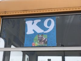 A poster in one of the bus's windows included a picture of Ozi surrounded by drawn hearts.