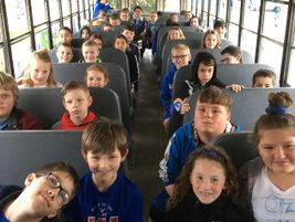 The students adorned the bus with posters and blue garlands. Theyalso wore blue, which they...