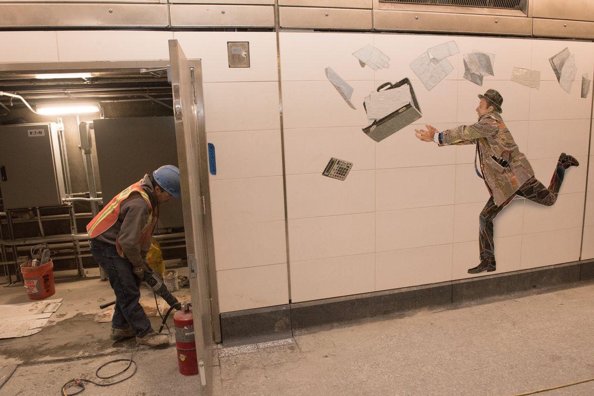 "At 72nd Street, Vik Muniz's installation, ""Perfect Strangers"" features more than three dozen..."