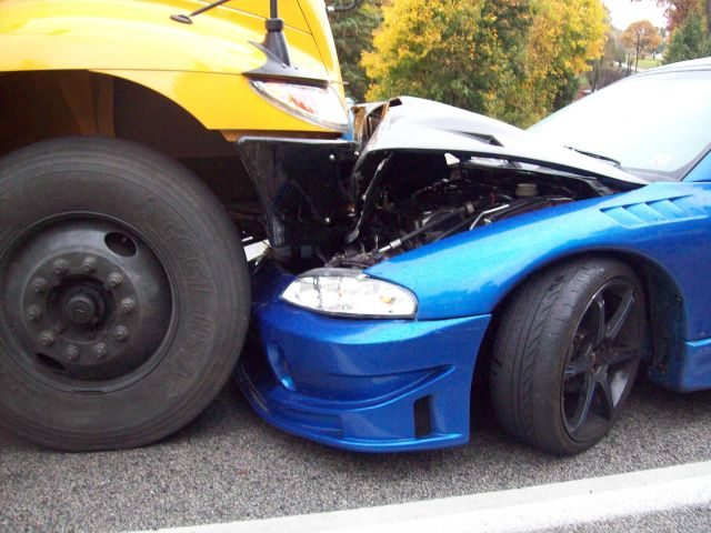 No injuries as car crashes head-on into school bus