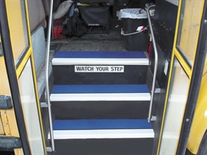 Safeguard Technology's step cover wraps over the leading edge of bus stairs for anti-slip protection.