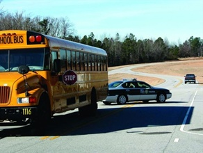 A national survey conducted by state pupil transportation directors this spring found that more than 76,000 vehicles illegally passed school buses in a one-day snapshot. Pictured is a demonstration of illegal passing during an Operation Stop Arm event in North Carolina a few years ago.