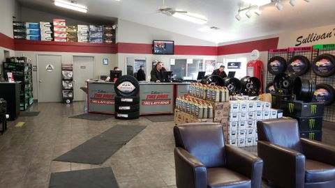 Twenty employees work from a small campus of four buildings at Sullivan's Tire Pros near...