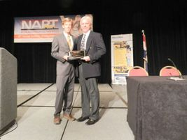 Beekman (right) became the 41st pupil transportation leader to receive the Administrator of the...