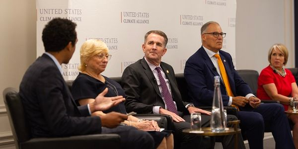 Gov. Ralph Northam (third from left) announcedVirginia's third round of VW funding during a...