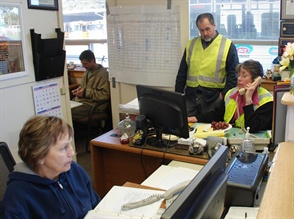 The Del Norte district's transportation office was the incident command center for evacuating residents before a tsunami hit. Pictured are (clockwise from top) lead mechanic Jess Bigham, driver instructor Carlina Horn, dispatcher Ellen Lemrise and Gary Gleason, vice president of NUSURA, who had been working with the district in training and planning for evacuations.