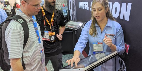Samantha Maloy, right, from Blackburn OEM Wheel Solutions, talks with Robert Tarr, left, and...