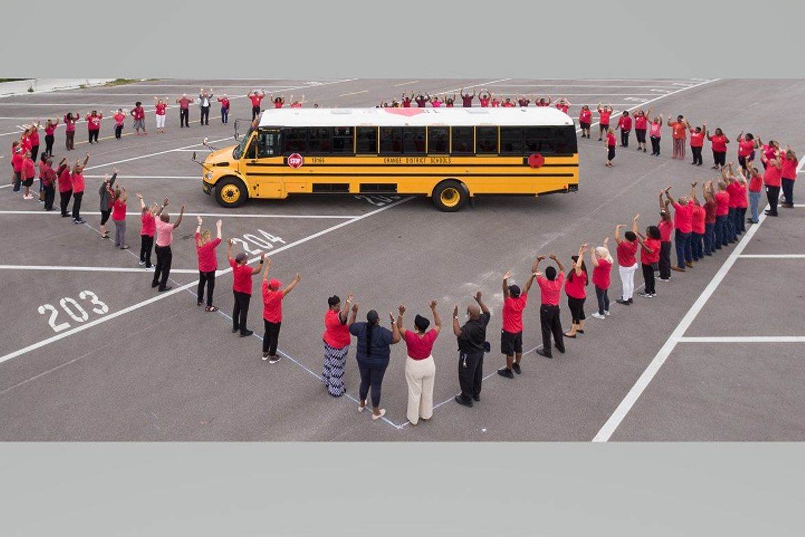 The district's transportation team showcased their creativity by forming a heart around the...