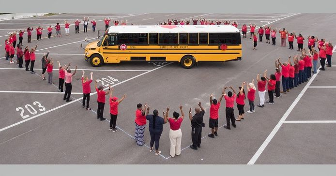 The district's transportation team showcased their creativity by forming a heart aroundthe...