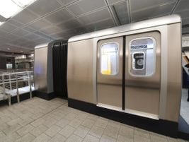 The R211 cars feature 58-inch-wide door openings, which are eight inches wider than standard...