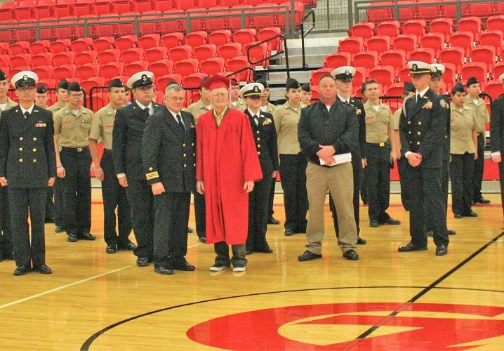 Cpl. Lewie Shaw (center), a former school bus driver for Claremore (Okla.) Public Schools, was...