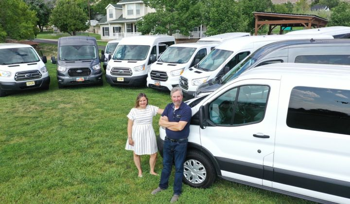 Rich Guernsey and Alexis Mahlum, owners of Rabbit Rentals, pose with their fleet of vans. Guernsey says teaming up with an FMC was one of their keys to success. Photo courtesy Rabbit Rentals. - Photo courtesy Rabbit Rentals