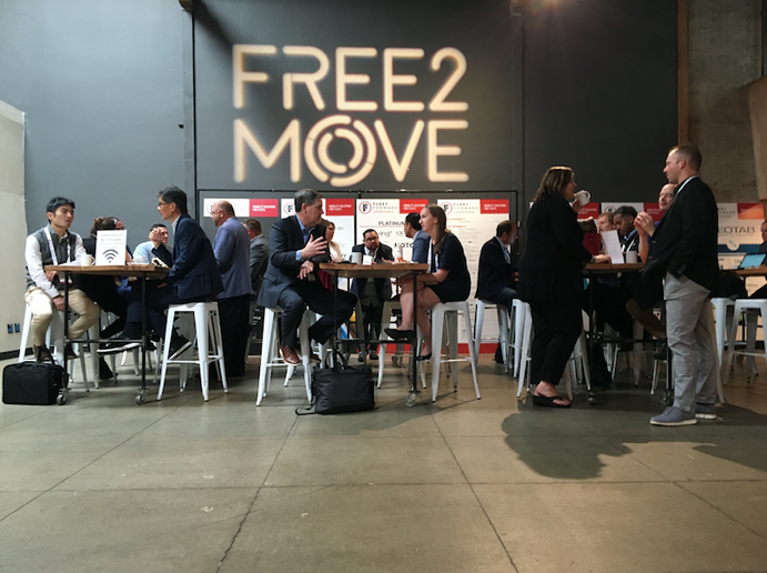 Free2Move, part of Groupe PSA's relaunch in the North American market, represents the new wave of shared mobility. Dubbed a mobility aggregation platform, the Free2Move app allows users to compare the location, characteristics, and operating costs of available transportation options. (Free2Move sponsored the 2019 Fleet Forward Conference, seen here.) - Photo by Tabrizi Productions.