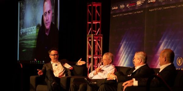 Sharky Laguana (left), owner of Bandago Van Rental, moderates a discussion with independent car...