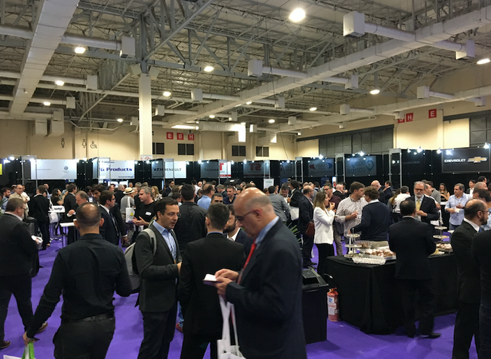 Forum ABLA featured a typical exhibit hall with vendor booths. Exhibitors included car rental software systems, vehicle manufacturers, insurance, banks, and new app-based service providers. - Photo by Chris Brown.