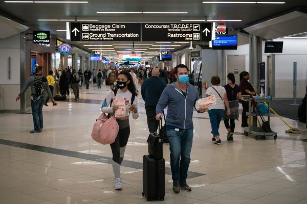 Flyers at Hartsfield-Jackson Atlanta International Airport wearing facemasks on March 6th, 2020 as the COVID-19 coronavirus spreads throughout the U.S. - Photo via Wikimedia and Flikr/Chad Davis.