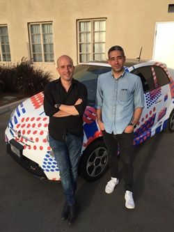 Co-founders Ori Sagie (left) and Aric Ohana stand in front of Envoy's branded community manager vehicle at the company's launch event in Culver City, Calif. - Photo courtesy of Envoy.