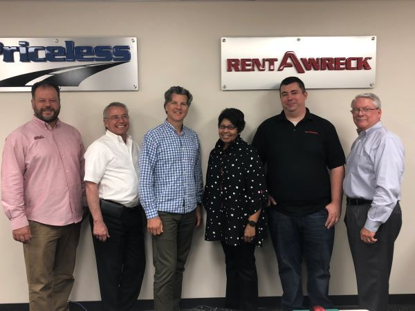 """Since 2004, Pat """"The Trainer"""" Bowie (center right) has provided training for all members of the NP Auto Group team, which oversees the NextCar, Priceless Car Rental, and Rent-A-Wreck brands. - Photo courtesy of NP Auto Group."""
