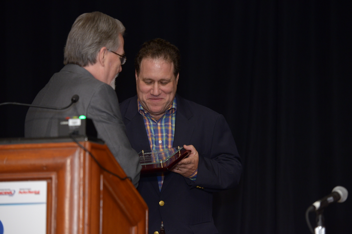 At the 2014 International Car Rental Show Bob Barton (right) receives an award commemorating his six-year term as president of the American Car Rental Association.